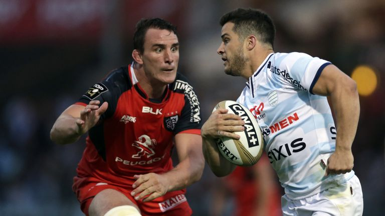Brice Dulin looks to outstrip Toulouse's number eight Louis Picamoles