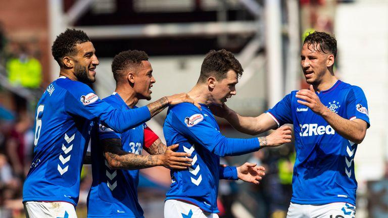 Ryan Jack celebrates with team-mates after scoring to make it 2-0