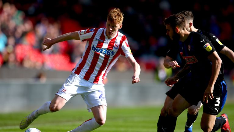 Stoke City's Sam Clucas and Rotherham United's Joe Mattock battle for the ball