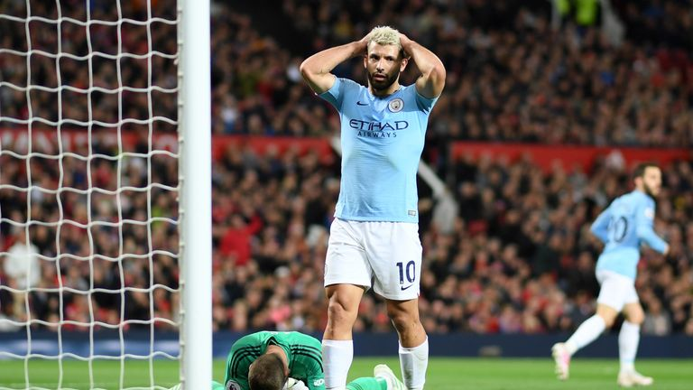 Sergio Aguero reacts after a missed chance