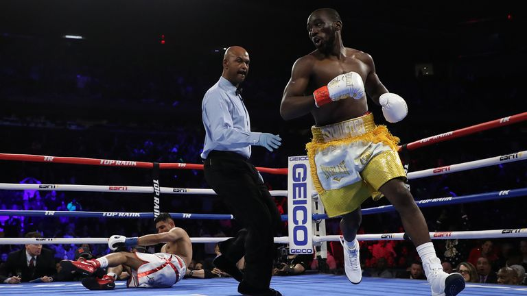 Khan is sent to the canvas in the opening round by Crawford