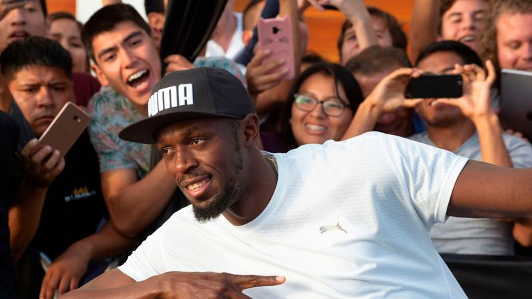 Bolt poses with hundreds of cheering fans