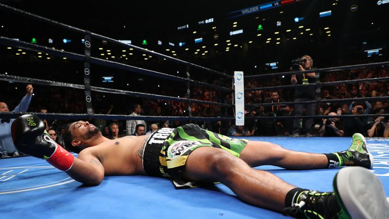 Dominic Breazeale lies on the canvas after being knocked out by Deontay Wilder