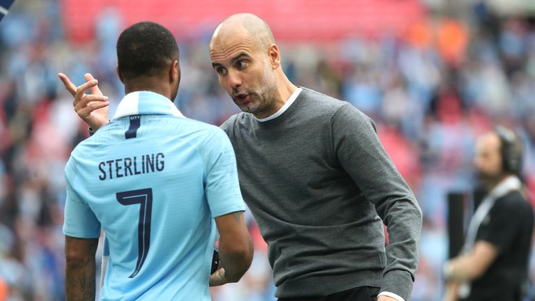 Manchester City's Raheem Sterling and manager Pep Guardiola