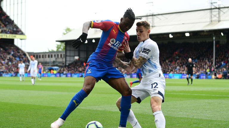 Crystal Palace's Aaron Wan-Bissaka shields the ball from Lucas Digne of Everton