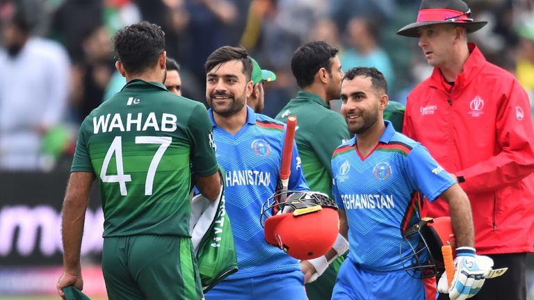 Rashid Khan and Hashmatullah Shahidi celebrate as Afghanistan clinch a three-wicket win over Pakistan