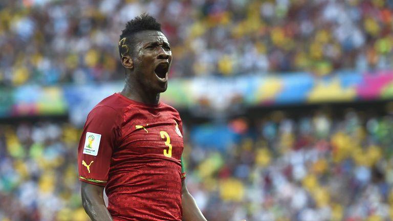 Asamoah Gyan celebrating scoring at the 2014 World Cup.