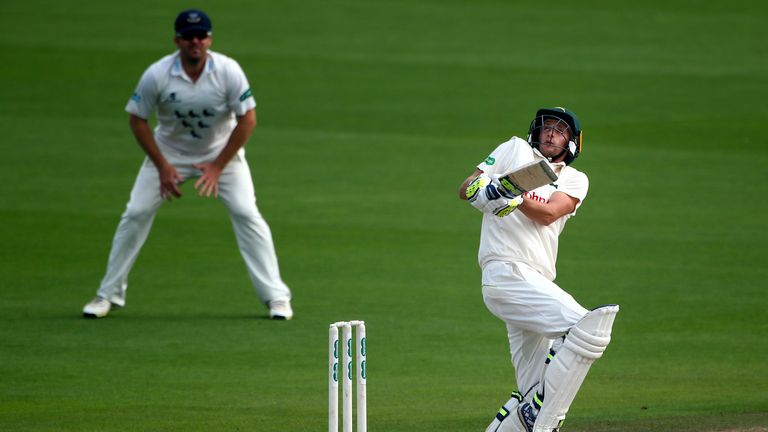Billy Root hit an unbeaten fifty for Glamorgan on the same day he was banned from bowling