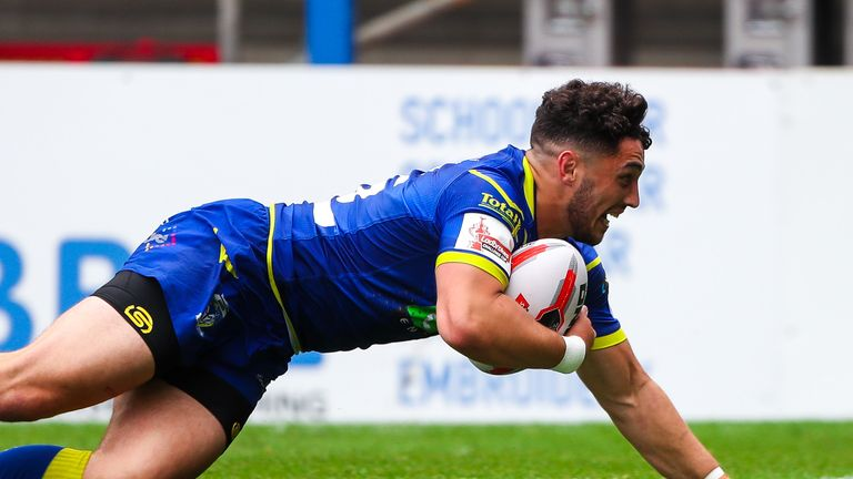 Declan Patton scores for Warrington against Wigan in the Challenge Cup last year
