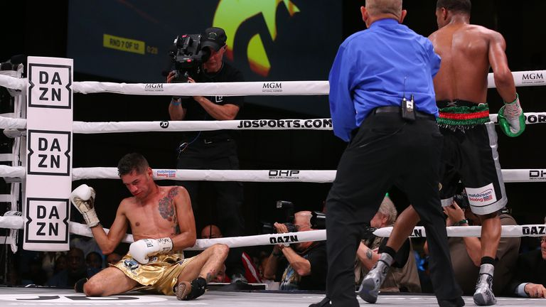 Moran is slumped on the canvas after being knocked out by Haney