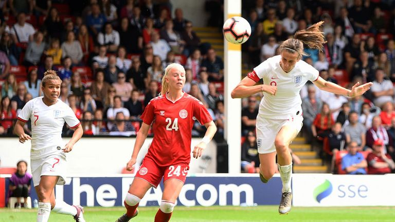 Jill Scott heads home England's second against Denmark