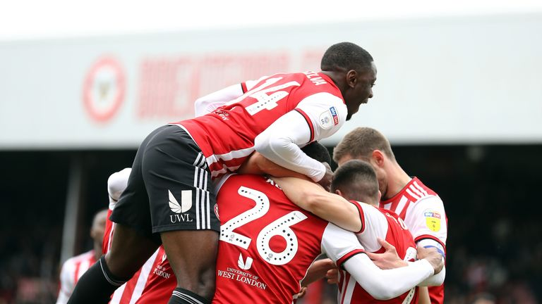 Ezri Konsa celebrates with team mates after scoring the opener
