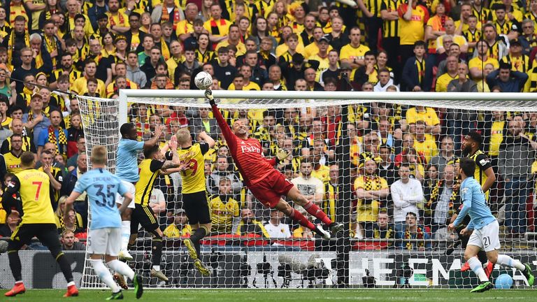 Heurelho Gomes punches the ball away