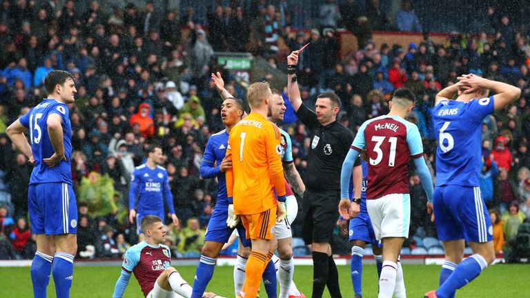 Leicester defender Harry Maguire is shown a red card against Burnley