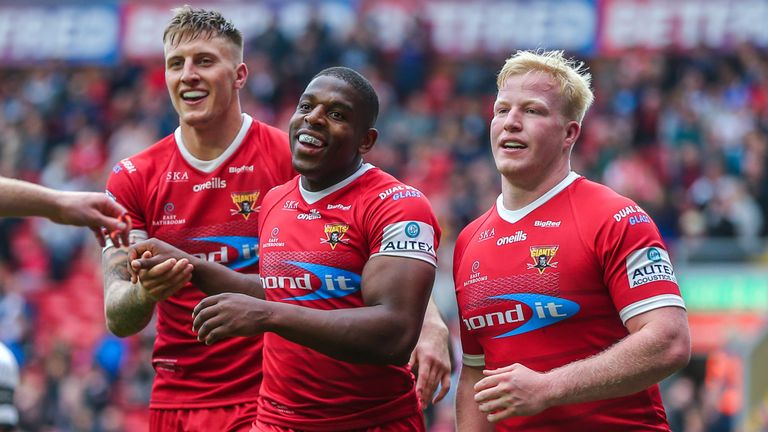 Jermaine McGillvary celebrates scoring a try in Huddersfield's win over Hull FC