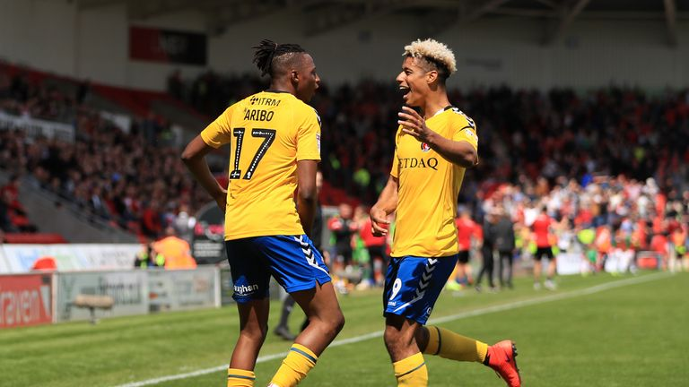 Goals from Joe Aribe and Lyle Taylor helped Charlton to victory at the Keepmoat Stadium in the first leg