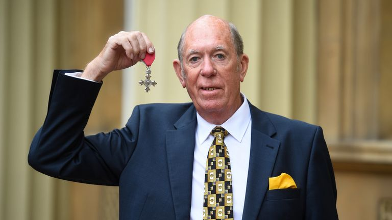 John Lowe with his MBE for services to darts and to charity after an investiture ceremony at Buckingham Palace