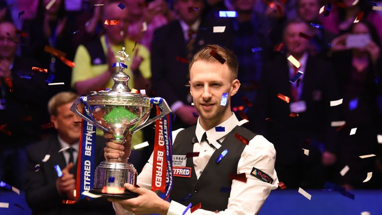Judd Trump celebrates winning the World Snooker Championship