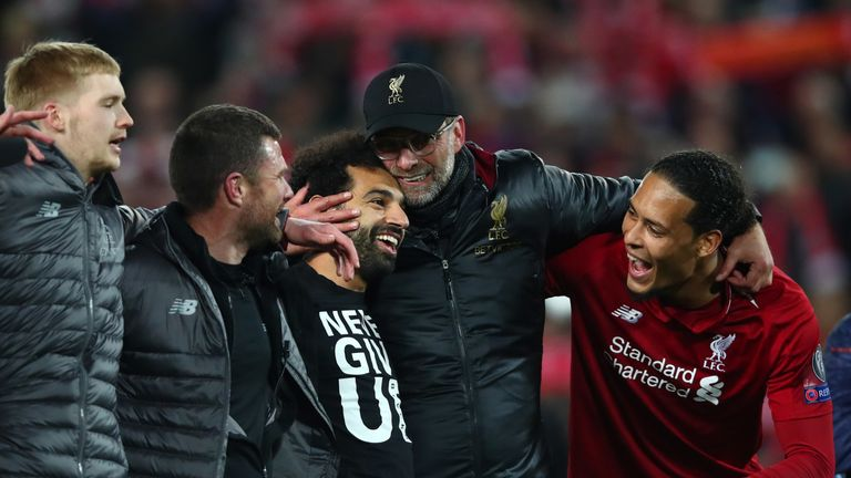 Klopp hugs his Liverpool players after the win