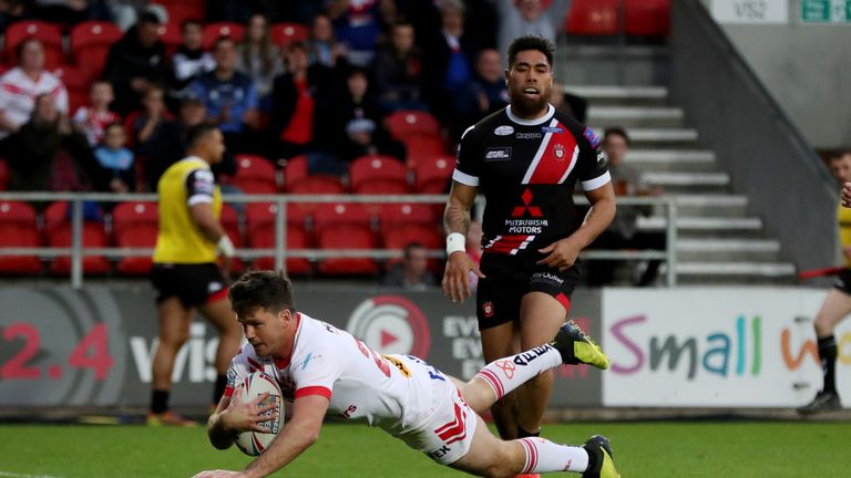 Lachlan Coote goes over for St Helens' second try