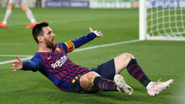 Lionel Messi celebrates after scoring Barcelona's third goal at the Camp Nou