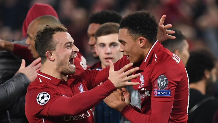 Trent Alexander-Arnold and Xherdan Shaqiri celebrate after Liverpool beat Barcelona 4-0 in the Champions League