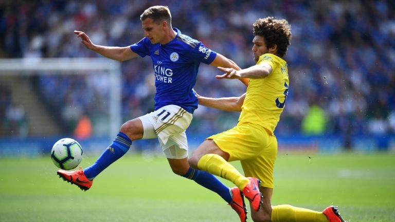 Marc Albrighton is challenged by Marcos Alonso
