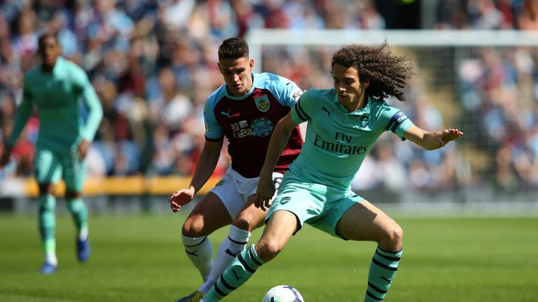 Matteo Guendouzi turns with the ball under pressure from Ashley Westwood