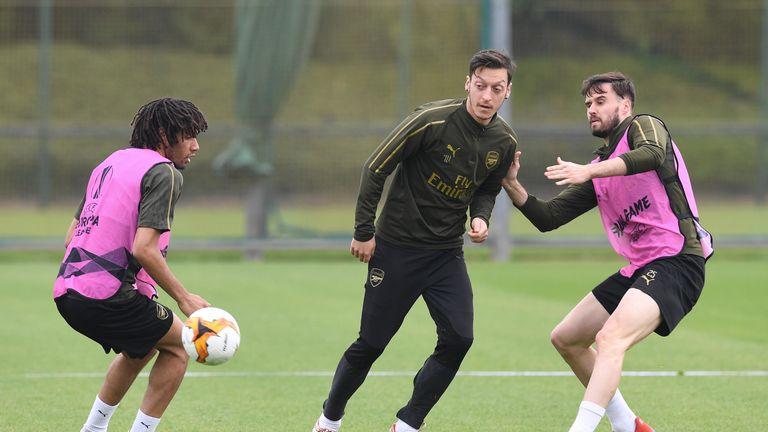 Mesut Ozil trains ahead of the Europa League semi-final first leg