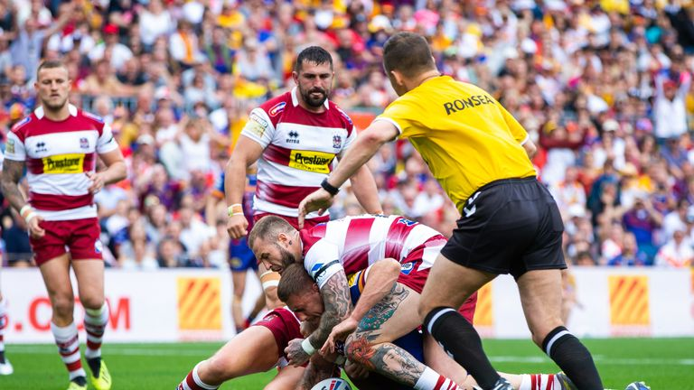 Michael McIlorum goes over for Catalans' first try against Wigan