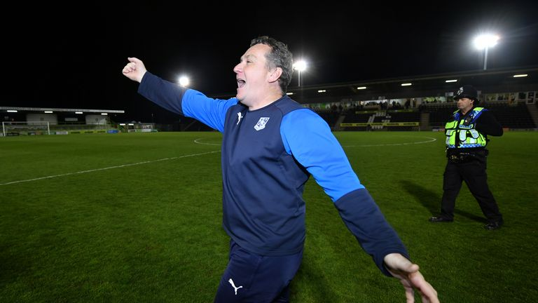 Mickey Mellon celebrates Tranmere's progression to the League Two play-off final