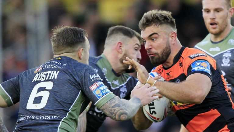 Mike McMeeken tackled by Warrington's Daryl Clark and Blake Austin