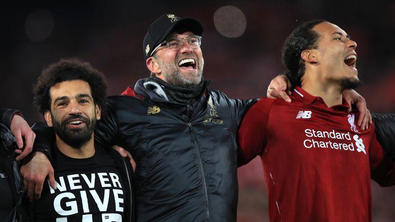Mohamed Salah, Jurgen Klopp and Virgil van Dijk celebrate after Liverpool's 4-0 win over Barcelona - © Xinhua News Agency/Shutterstock