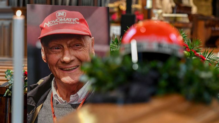 In the morning his coffin was placed in St Stephen's Cathedral, with his iconic red racing helmet on top