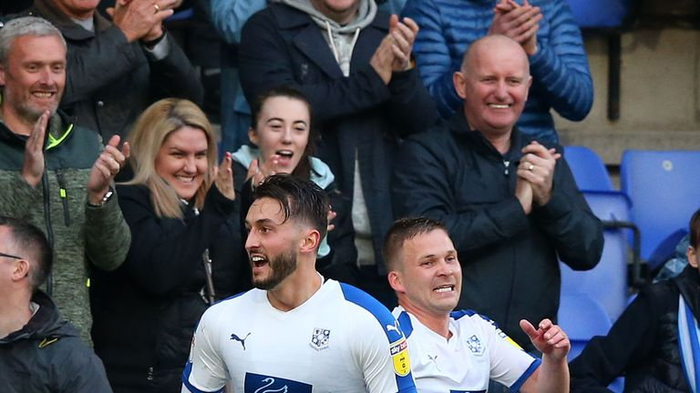 Ollie Banks celebrates with Jay Harris after scoring for Tranmere against Forest Green