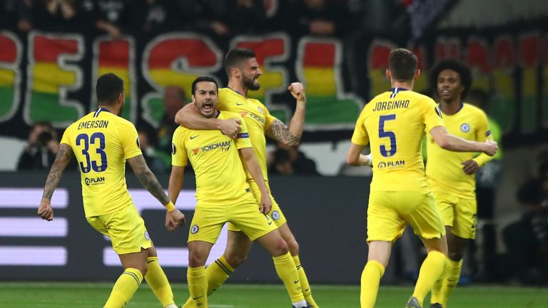 Pedro and Olivier Giroud celebrate in the first leg
