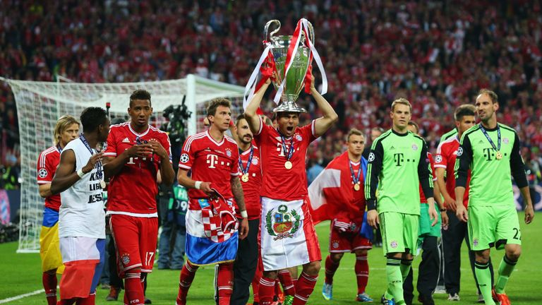 Claudio Pizarro lifting the Champions League in 2013 after Bayern Munich's victory over Borussia Dortmund at Wembley Stadium.