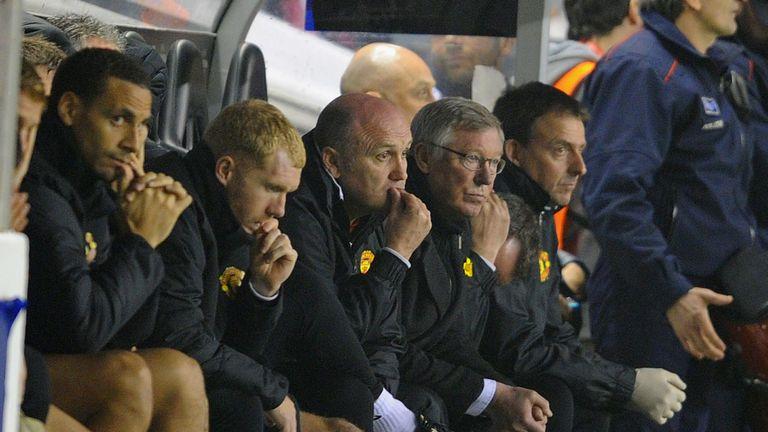 Mike Phelan on the bench alongside Ferguson and Ferdinand in 2012