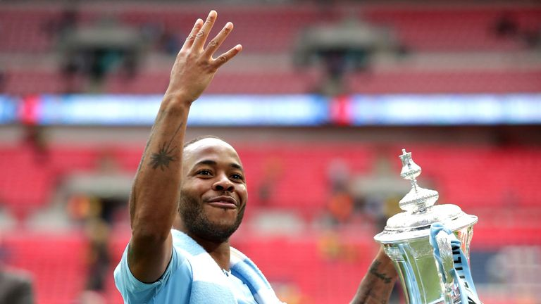Sterling celebrates after winning the FA Cup, which completed a historic domestic treble