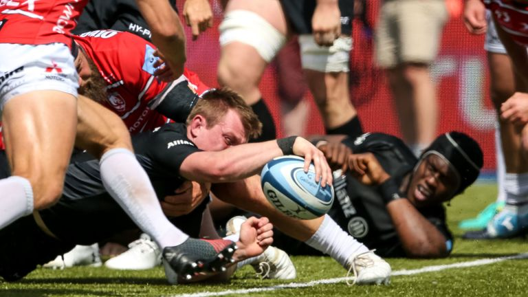 Tomkins reaches out to secure his hat-trick score