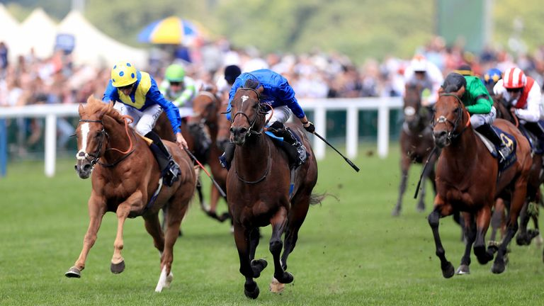 Blue Point (centre) ridden by jockey James Doyle, wins the Diamond Jubilee Stakes from Dream Of Dreams (left)