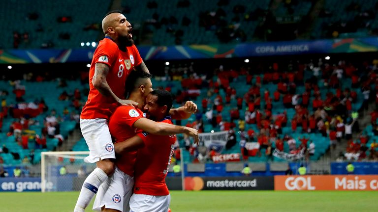 Alexis Sanchez celebrates his winner against Ecuador