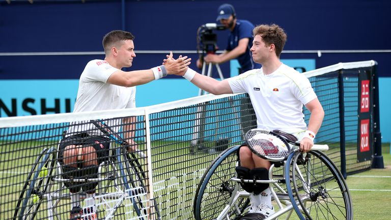 Hewett (right) shakes hands with Reid after the final