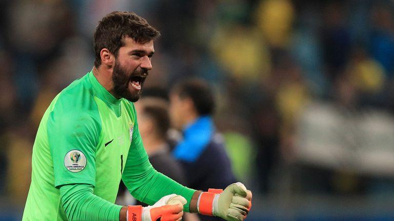 Brazil No 1 Alisson celebrates his decisive penalty save against Paraguay
