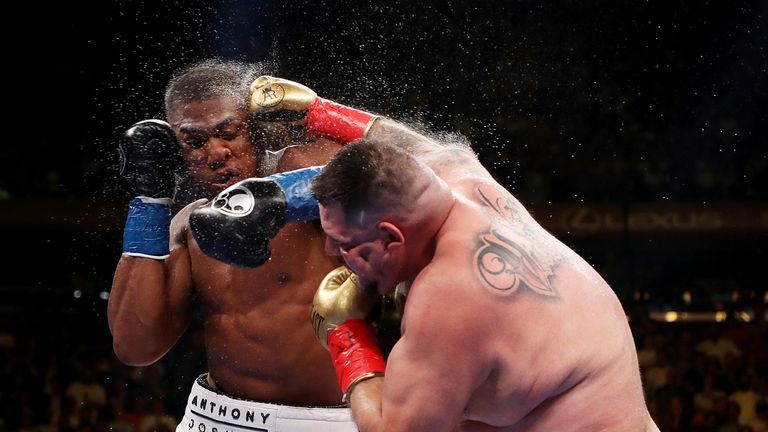 Joshua was knocked down four times before the referee called a halt to the contest