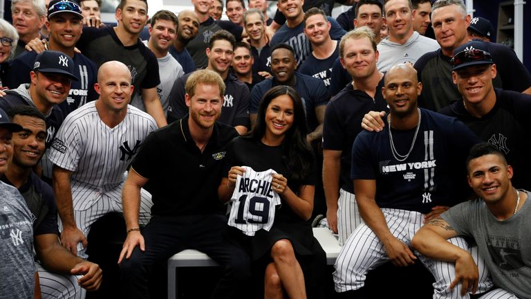 The royal couple pose for a photo with the New York Yankees