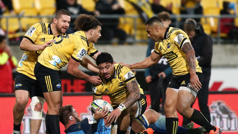 Ben Lam celebrates a try for the Hurricanes with his team-mates