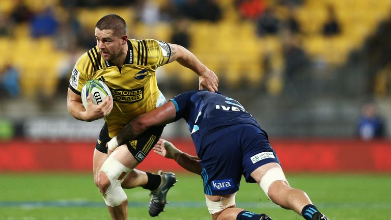Dane Coles is tackled by Scott Scrafton as Hurricanes beat Blues