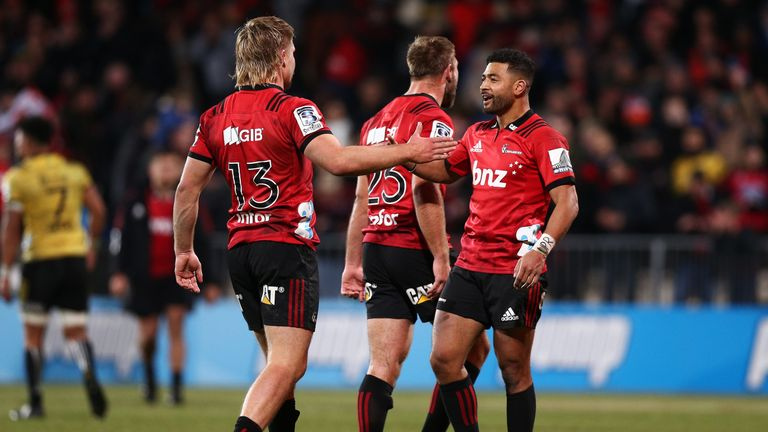 Richie Mo & unga and Jack Goodhue celebrate the victory of crusaders over hurricanes