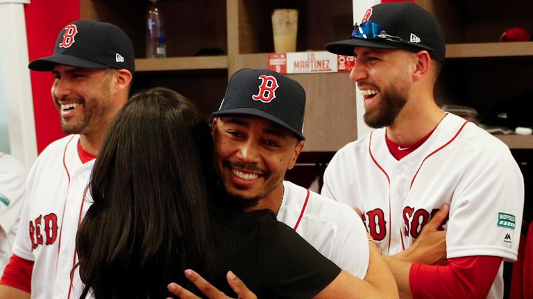 The Duchess of Sussex shares a hug with her 'cousin' Boston Red Sox's Mookie Betts